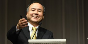 Chairman of Japanese mobile carrier SoftBank, Masayoshi Son, gestures during a press conference announcing the company's earnings in Tokyo on November 4, 2014. SoftBank said net profit in the first six months of its fiscal year jumped by more than a third, thanks to a five-billion-USD gain from its stake in Chinese e-commerce giant Alibaba. AFP PHOTO / TOSHIFUMI KITAMURA (Photo credit should read TOSHIFUMI KITAMURA/AFP/Getty Images)